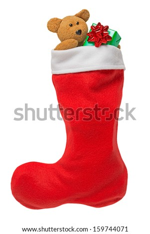 Red Christmas stocking with gifts and handmade teddy bear isolated on white - stock photo