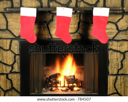 Red christmas stockings hung by the fireplace with care - stock photo