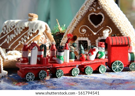 Red Christmas toy train with bear and snowman and wreath - stock photo