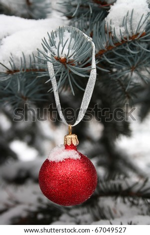 Red Christmas-tree decoration and blue Christmas tree - stock photo