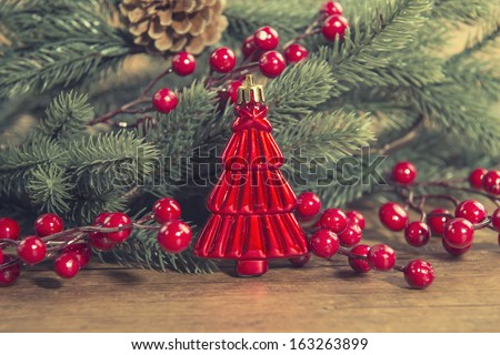 red Christmas tree on old wooden background - stock photo