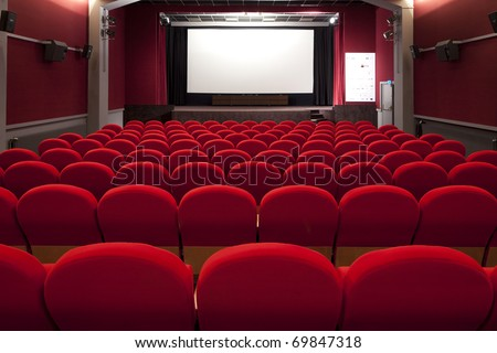 red cinema empty projection screen for insert a picture - stock photo