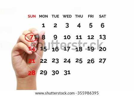 Red circle. Businessman mark on the calendar at 7 - stock photo