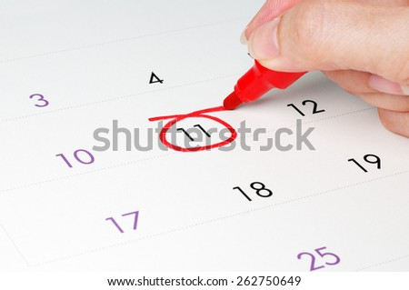 Red circle. Mark on the calendar at 11.  - stock photo