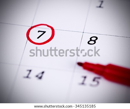 Red circle. Mark on the calendar at 7. - stock photo