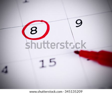 Red circle. Mark on the calendar at 8. - stock photo