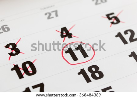 Red circle marked on a calendar and X Mark for counting down. concept for an important day. - stock photo