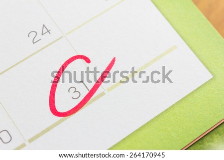Red circle on calendar at the last day of month. - stock photo