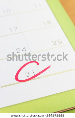 Red circle on  calendar at the last day of month - stock photo