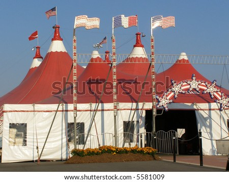 Red Circus Tent with neon lights and flags