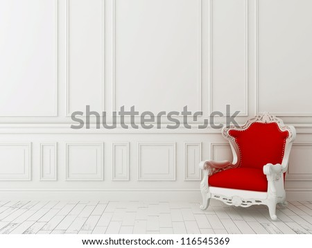Red classic armchair against a white wall and white floor - stock photo