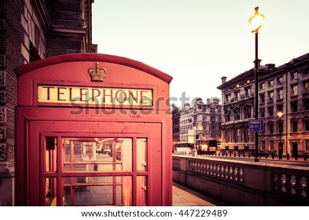 Red Classic British telephone box in London, Vintage photo. - stock photo