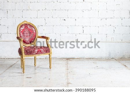 red classic chair style in vintage room with white wall - stock photo