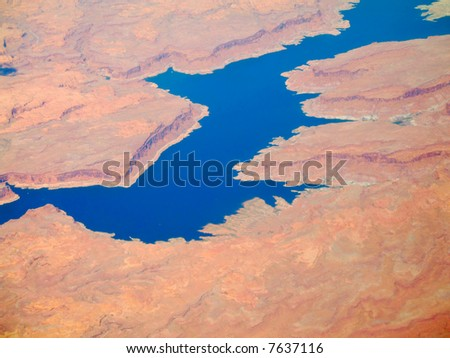 Red cliffs along Lake Powell, Utah, from 30,000 feet
