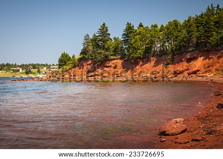 Red cliffs of Prince Edward Island Atlantic coast near Cavendish, PEI, Canada. - stock photo