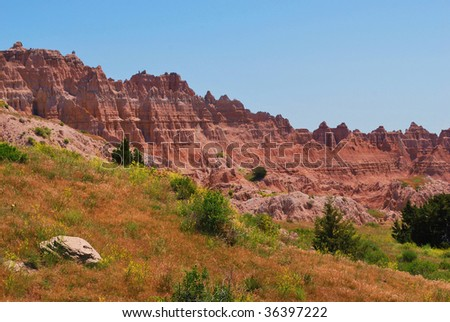 red cliffs on edge of Badlands South Dakota national park usa - stock photo