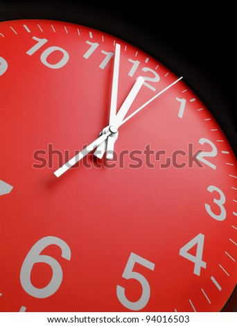 Red clock face, close up - stock photo