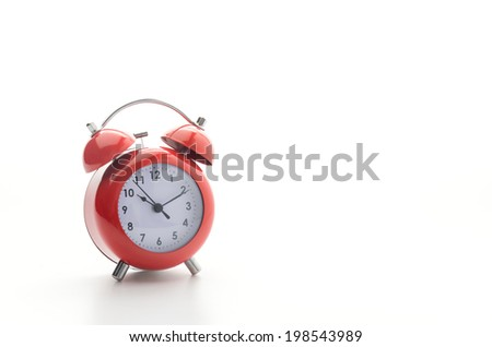Red clock isolated on white