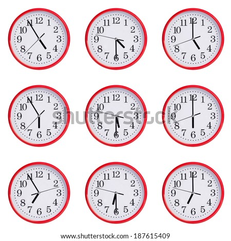 Red clock shows the time of five to seven - stock photo