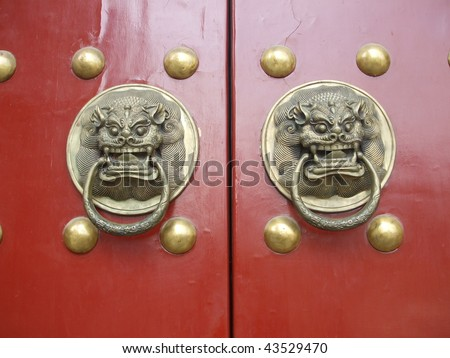 Red Closed Door with Lion Figures