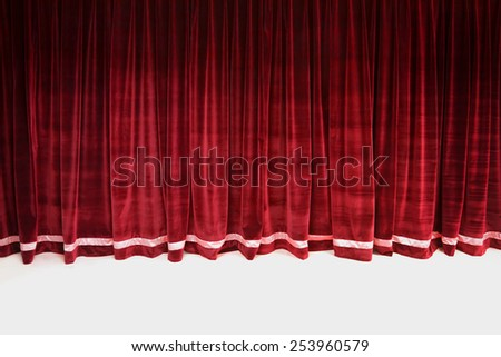 Red closed velvet curtain in a theater - stock photo