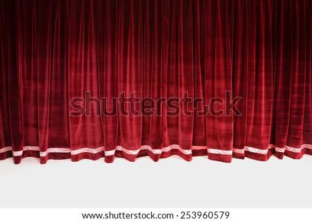 red closed velvet curtain in a theater - Velvet Curtain