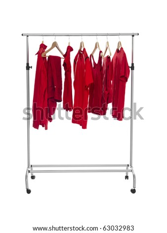 Red clothes on a Rack isolated on white background - stock photo