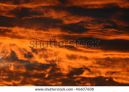 red clouds on sky after sunset - stock photo