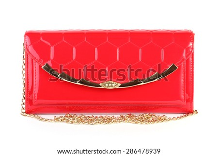 Red clutch bag isolated on white background - stock photo