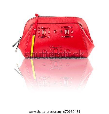 Red clutch on reflected surface.Isolated on white background.Front view.