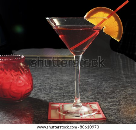 red cocktail at a bar