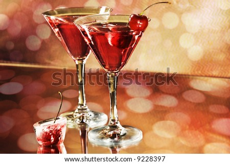 Red cocktail in a martini glasses on holiday background - stock photo