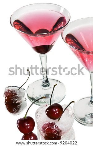 Red cocktail in martini glasses on white - stock photo