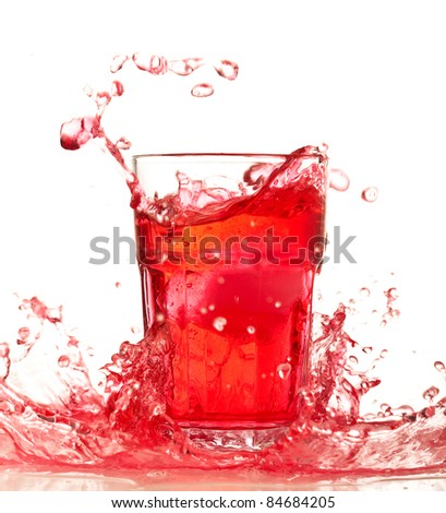 Red cocktail on a glass on white background