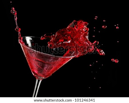 Red cocktail splash in a martini glass - stock photo