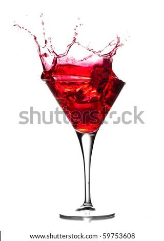 Red cocktail splash on white background. - stock photo