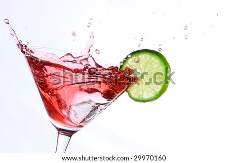 red cocktail with lime on white - stock photo