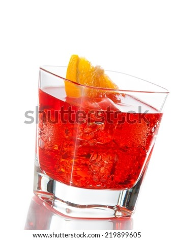 red cocktail with orange slice tilted isolated on white background with space for text - stock photo