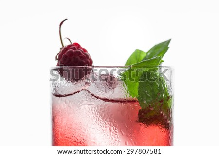 Red cocktail with raspberry - stock photo
