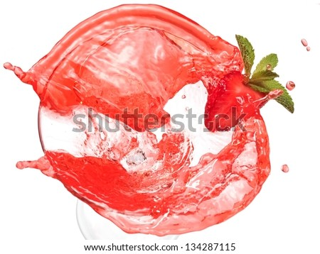 Red cocktail with strawberry splash, top view