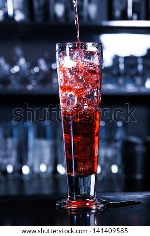 Red coctail with ice cubes - stock photo