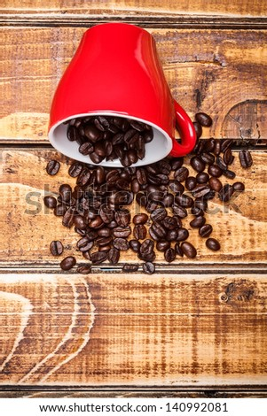 Red coffe cup with coffe beans - stock photo