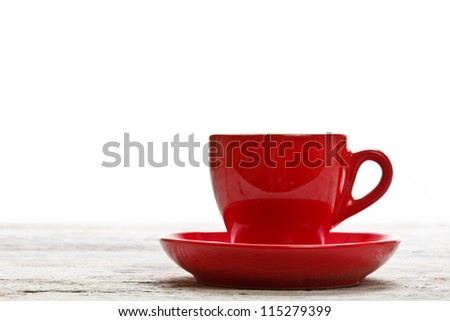 Red coffee cup on wood background - stock photo