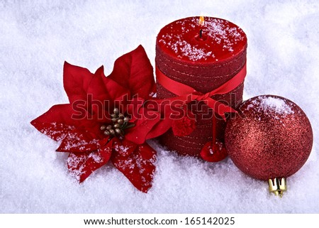 Red color Christmas ornaments.Poinsettia candle and bauble,snowflakes on background  - stock photo