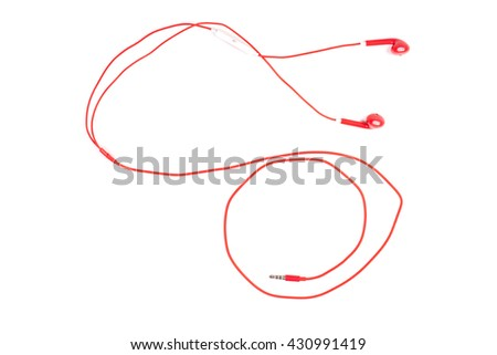 Red color earphone on background.