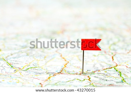Red color flag pin on map, shallow focus - stock photo