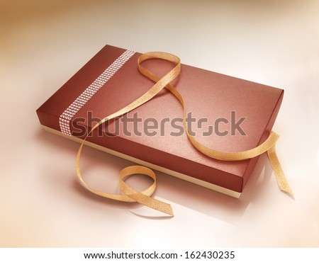 Red color gift box with loop. Christmas concept - stock photo