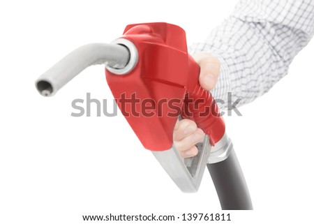 Red color gun from the fuel pump in hand and isolated on white - stock photo