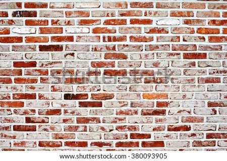 Red color of modern style design decorative brick wall surface with cement - stock photo