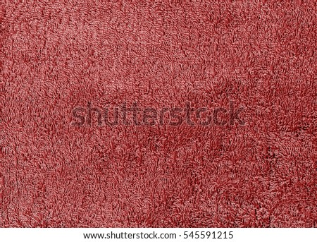 Red color textile towel texture. Background and texture.
